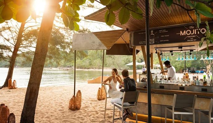 Couple at a beach bar on their Thailand honeymoon