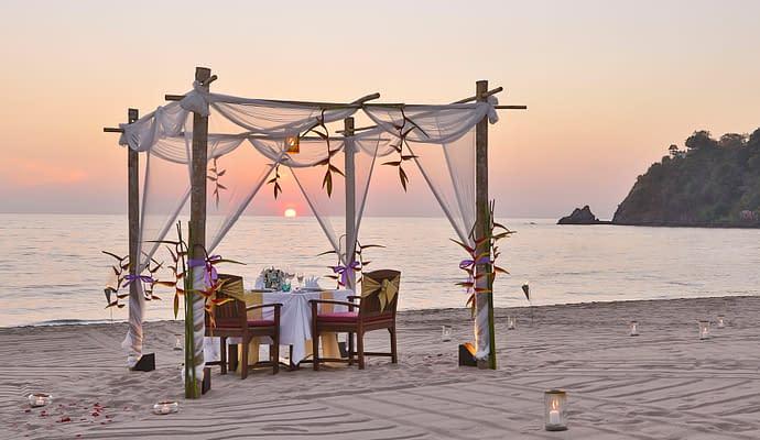 Romantic honeymoon dinner set up on the beach in Thailand